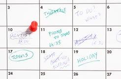 Thumb tack on calendar Stock Image