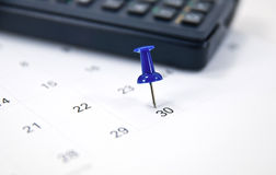 Thumb tack on calendar Royalty Free Stock Photography