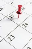 Thumb Tack on Calendar. Red Thumb Tack on Calendar Page royalty free stock image
