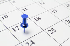 Thumb Tack on Calendar. Blue Thumb Tack on Calendar stock photography