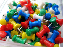 Thumb Tacks. Close up on multi-colored thumb tacks stock photos