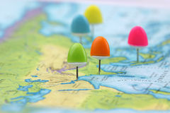 Thumb tacks on Asia map. Colorful thumb tacks pointing major Asian cities stock images