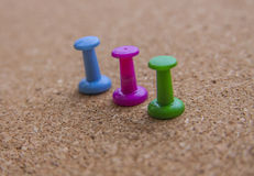 Thumb tacks on Cork Royalty Free Stock Photos