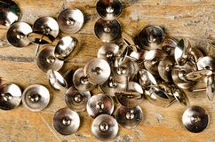 Thumb tacks on a wooden board. Many thumb tacks on a wooden board, office supplies Royalty Free Stock Photography