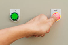 Thumb touch on red off switch Stock Photos