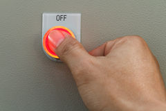 Thumb touch on red off switch Stock Photography