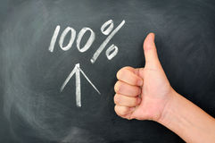 Thumb up with a 100 percent sign Royalty Free Stock Photography