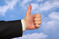 Thumb up. Gesture over sky and clouds backgound Stock Image