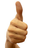Thumb up. The hand of the young man shows his thumb up on a white background royalty free stock photography