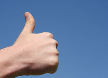 Thumb up. Against blue sky royalty free stock photography