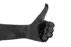 Thumb up. Hand wearing a black glove and doing a thumb uo gesture isolated on white Stock Photography