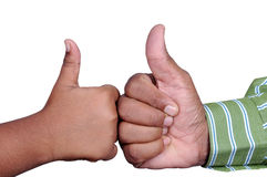 Thumb up. Two supportive young holding up their thumbs Stock Image