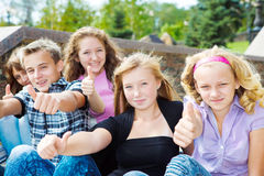 Thumb up. Happy teenagers showing thumb up Stock Images