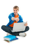 Thumb up. Teenager with a laptop holding one thumb up Royalty Free Stock Photos