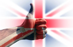 Thumb up. Hand with thumb up and south great britain flag in background Royalty Free Stock Photos
