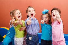 Thumb up. Group of cheerful children showing thumb up Royalty Free Stock Image