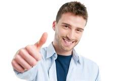 Thumb up. Happy smiling guy showing thumb up isolated on white background Stock Photo