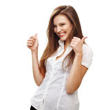 Thumb up. Young female  express happiness with thumb up sign. Isolated on white Royalty Free Stock Photography