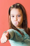 Thumb up. Young girl enjoying a bubble gum Stock Image