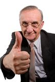 Thumb up!. Old happy businessman with glasses showing thumb up sign Stock Photos