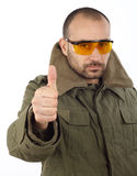 Thumb up. Portrait of man with goggles, thumb up Stock Photography