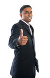 Thumb up. Excited thumb up 30s Indian businessman in black suit isolated on white background Stock Images
