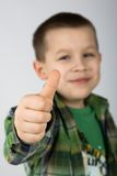 Thumb up !. Eight years old caucasian boy with his thumb up. Shallow DOF (only the palm is in focus royalty free stock photo