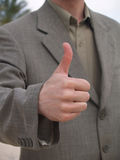Thumb up. Man in suit with thumb up Royalty Free Stock Photography