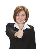 Thumb-up. Businesswoman making a characteristic thumb-up gesture Royalty Free Stock Image