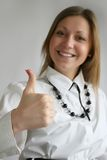 Thumb up. Beautiful businesswoman with her thumb up Royalty Free Stock Images