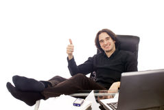 Thumb Up. A relaxed businessman in his office, showing thumb up. Isolated on white Stock Photos