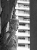 Thumb up. Angel statue in Buddhist temple act thumb up in black and white Royalty Free Stock Images