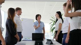 Thumb up and applaud Business partners and congratulation with profitable deal in boardroom stock footage
