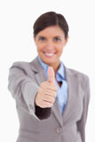 Thumb up being given by female entrepreneur Royalty Free Stock Image