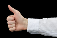 Thumb up on black background Royalty Free Stock Images