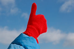 Thumb up on blue sky Royalty Free Stock Images