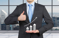 Thumb up. Businessman showing thumb up and holding chart Royalty Free Stock Photo