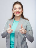 Thumb up. Casual style young woman isolated studio background. Royalty Free Stock Image