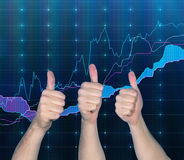 Thumb up and chart. Hand showing thumb up on forex chart background Stock Photo