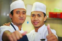 Thumb up chef. Photograph of two thumb up chef stock photography