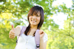 Thumb up college girl Royalty Free Stock Photos