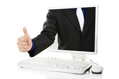 Thumb up from computer Royalty Free Stock Image