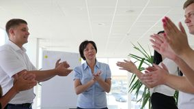 Thumb up and congratulation and clapping of business people with profitable deal in white boardroom stock footage