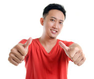 Thumb up cool young Southeast Asian man Royalty Free Stock Photos