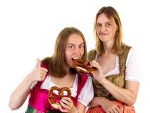 Thumb up for delicious oktoberfest pretzel Stock Images