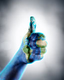 Thumb Up - Earth Day stock photo