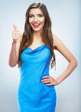 Thumb up. Evening blue dress. Young smiling woman.Isolated Stock Images