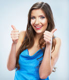 Thumb up. Evening blue dress. Young smiling woman. Stock Image