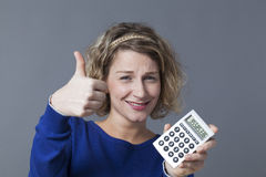Thumb up for for financial win by young female entrepreneur Royalty Free Stock Photography