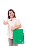 Thumb up gesture from happy middle aged asian woman Stock Photo